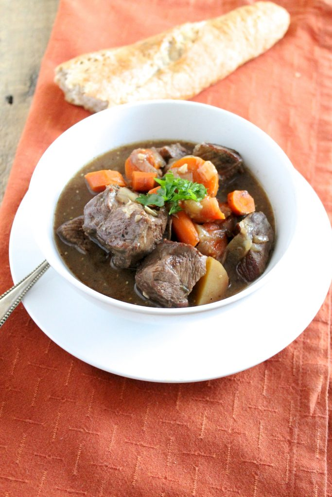 Healthy Slow Cooker Beef Stew in White Bowl with Baguette | www.littlechefbigappetite.com 1