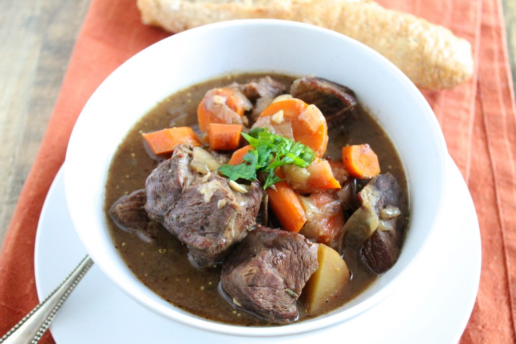 Healthy Slow Cooker Beef Stew in White Bowl with Baguette | www.littlechefbigappetite.com 2