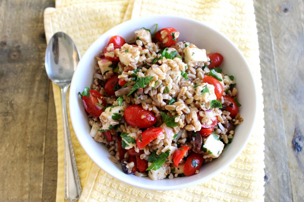 Summer Farro Salad with Cherry Tomatoes, Mozarella, and Fresh Basil ll A healthy and filling vegetarian salad that's perfect for meal prep and potlucks! ll www.littlechefbigappetite.com