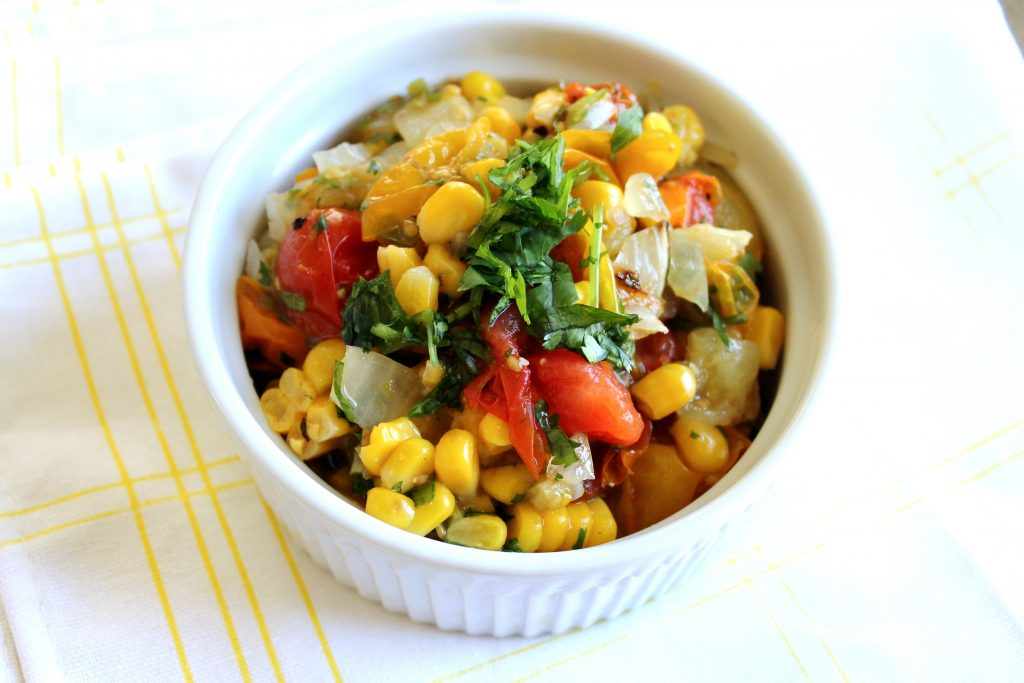 Charred Corn and Heirloom Tomato Salsa in a White Serving Bowl with Cilantro on top | www.littlechefbigappetite.com