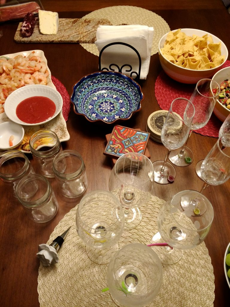 Appetizer Spread with Shrimp, Chips, Dip, Wine Glasses | www.littlechefbigappetite.com