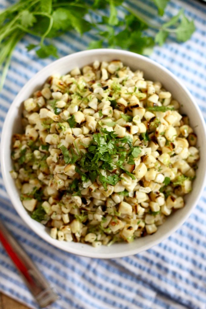 This Healthy Grilled Lime Corn Salad is the perfect summer BBQ side dish! ll www.littlechefbigappetite.com