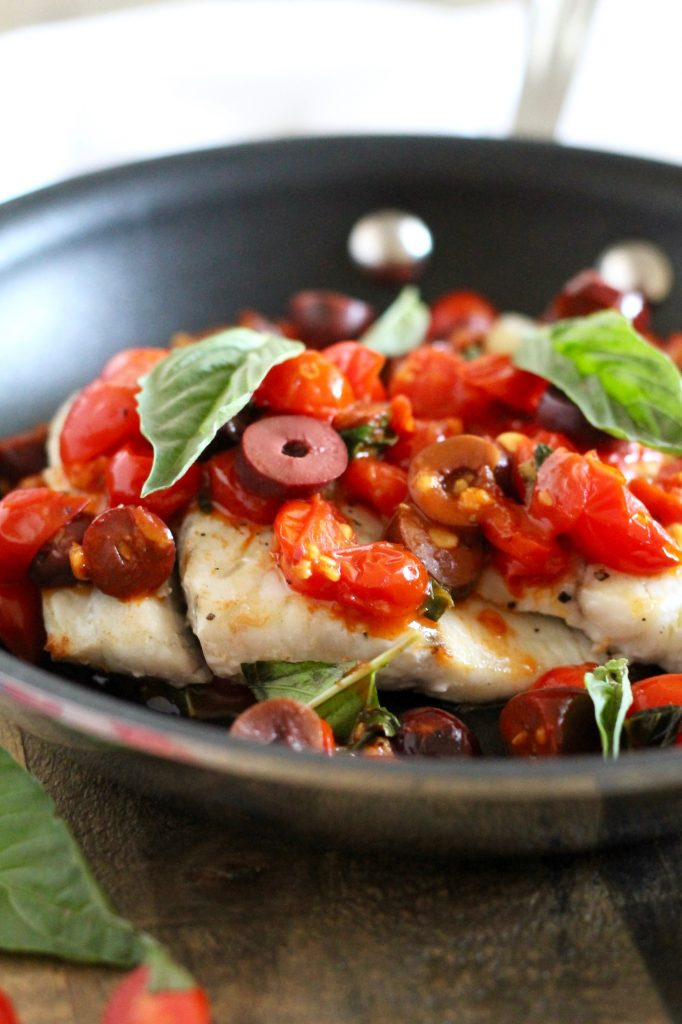 This Barramundi with Tomato, Olive, White Wine Sauce Recipe is so healthy and incredibly flavorful! It's easy enough to throw together for a quick weeknight dinner, but also impressive enough to serve to guests! ll www.littlechefbigappetite.com