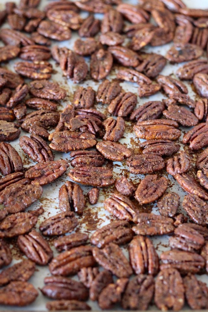 These Holiday Spiced Pecans are a delicious snack for guests to munch on before dinner! Or put some in a baggie and tie it up with ribbon to give as a gift. They're vegetarian, gluten-free and refined sugar free. ll www.littlechefbigappetite.com